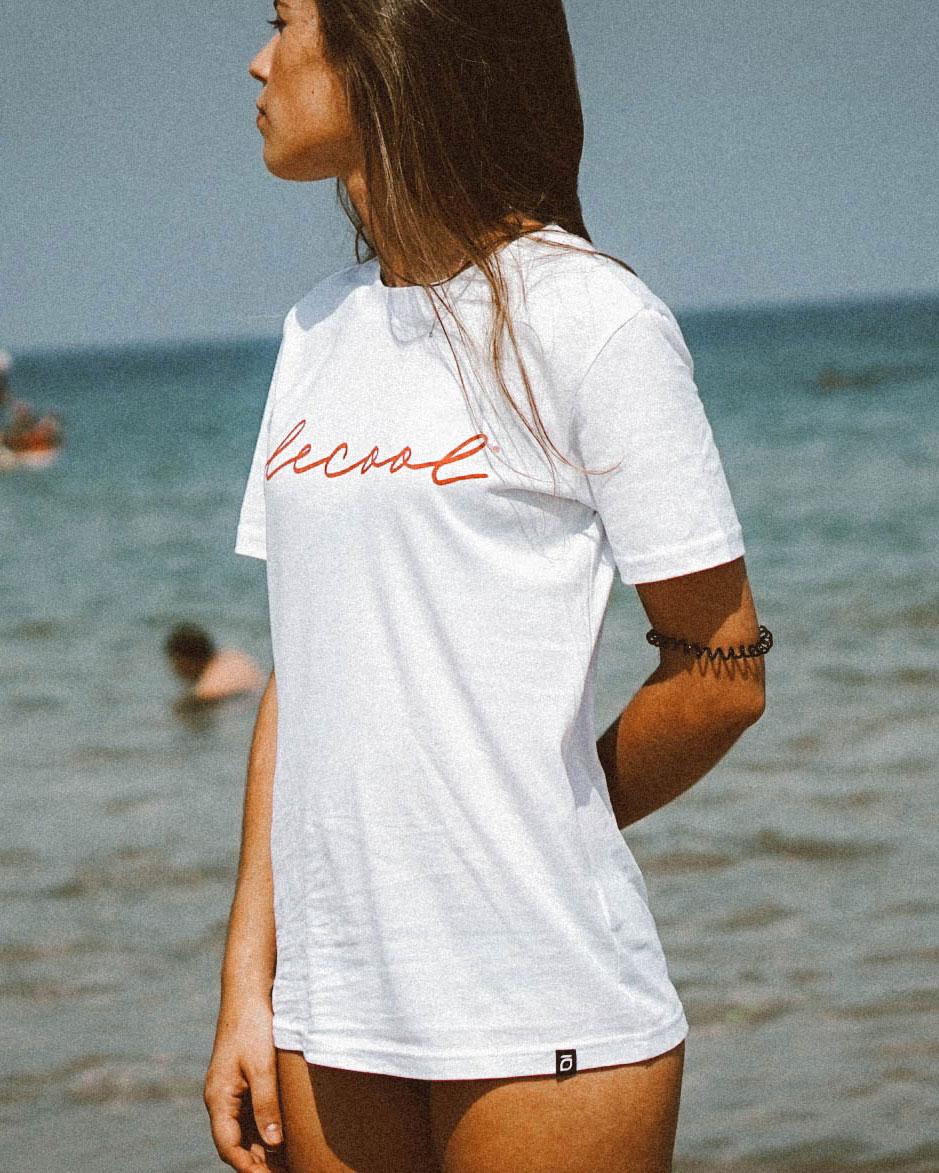 Camiseta algodón manga corta de mujer de Olé Cool en color blanco con letras rojo